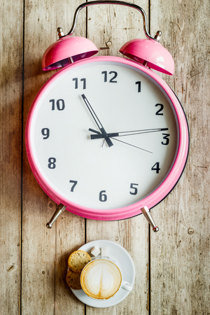 Pink Alarm Clock On A Wooden Table Top View Stock Photo   63193871