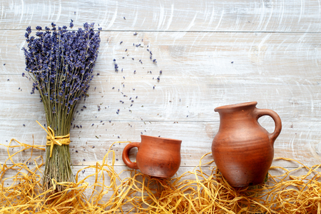 country life: still life pottery and lavender - country life on wooden background