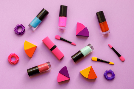 scrunchy: concept cosmetic set on pink background top view. Stock Photo
