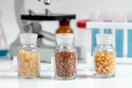 sample tray: cereals in glass vials for analysis in laboratory on microscope backround