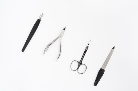 pinzas: manicure instruments set on white background top view on white backround