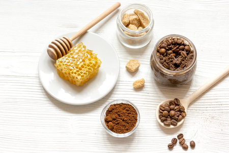 preparation scrub of ground coffee and honey top view on wooden background Stock Photo