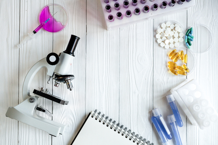 lab assistant: workplace lab assistant with microscope at the clinic top view no one