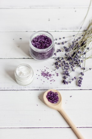 revitalizing: natural cream with lavender flowers on wooden table top view
