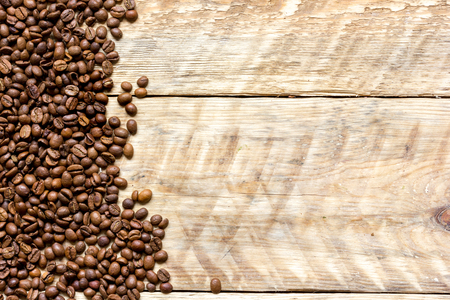 table top: coffee beans on wooden table top view. Stock Photo