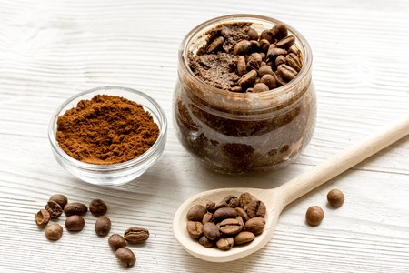 handmade coffee -cocoa scrub in glass jar on wooden background close up