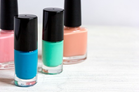 beautycare: group of nail polish on wooden background.