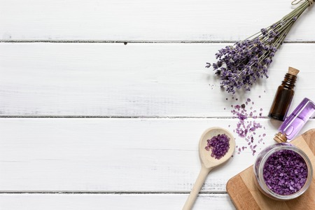 Essential oil and lavender salt with flowers top view wooden background Stock Photo