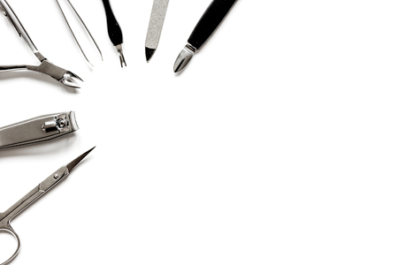 manicure set: Tools of a manicure set on white background top view. Stock Photo