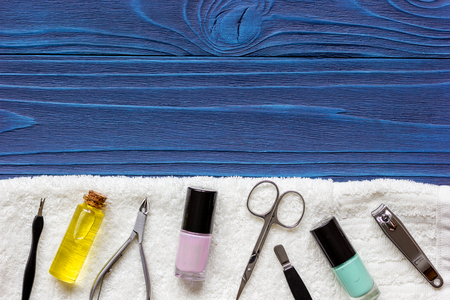 nail polish and manicure set on dark wooden background top view Stock Photo