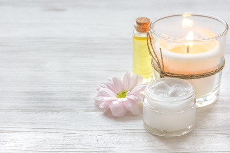 spa flower: spa nail care with aroma candle, flower on wooden background