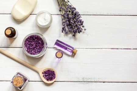 revitalizing: natural creams with lavender flowers on wooden table top view