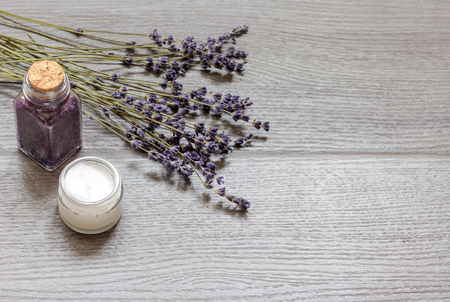 revitalizing: cosmetic creams with lavender flowers on black wooden table top view Stock Photo