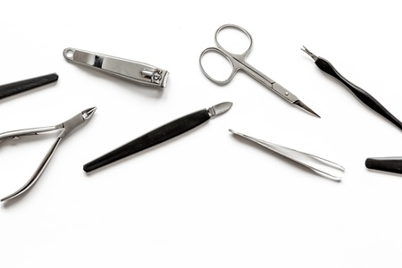 manicure set: nail care - manicure set on white background top view.