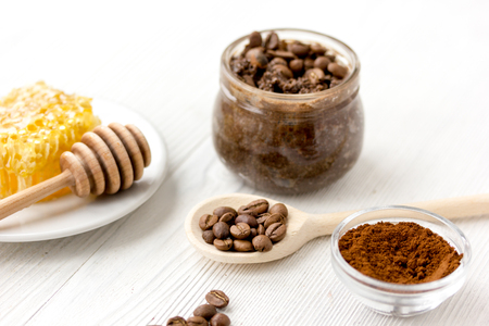 preparation scrub of ground coffee and honey on wooden background