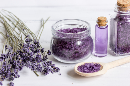 aroma facial: organic cosmetics with lavender on wooden background.
