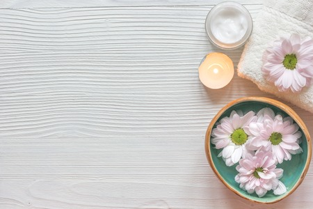 tea candle: spa nail care with tea candle, flower on wooden background top view
