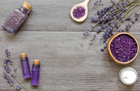 aroma facial: organic cosmetics with lavender on wooden background top view. Stock Photo