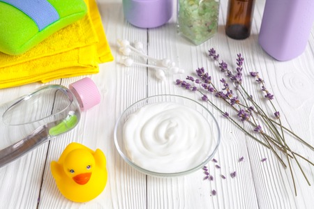 set baby care for bathroom with lavender on wooden background