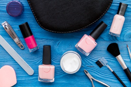 manicure set: cosmetic and manicure set on dark wooden background top view Stock Photo