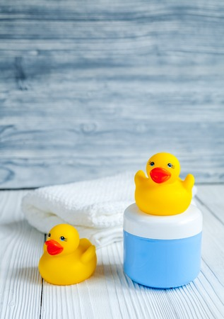 bakground: baby organic cosmetic for bath on wooden bakground close up Stock Photo