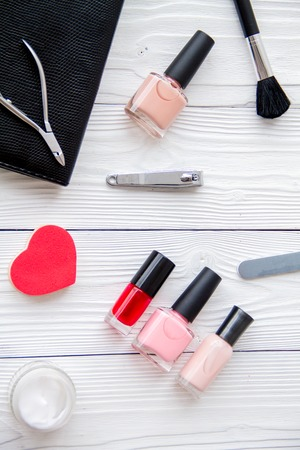 manicure set: manicure set and nail polish on wooden background top view