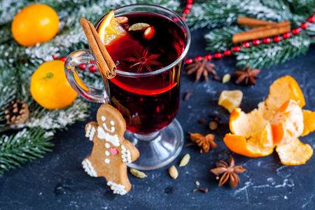 overturn: Christmas mulled wine with spices in cup on dark background clos