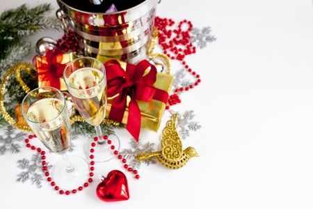 glasses of champagne and christmas ornaments top view on white background stock photo 66157780