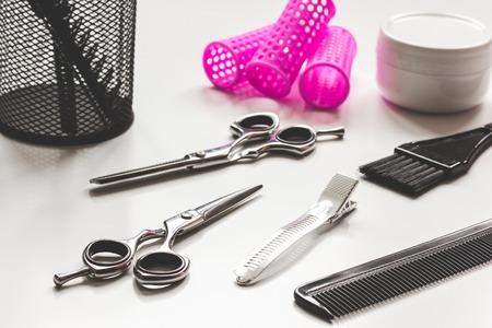 cutting hair: hairdresser working desk preparation for cutting hair close up