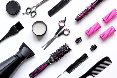 styler: combs and hairdresser tools on white background top view.