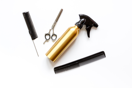 combs and hairdresser tools on white background top view.