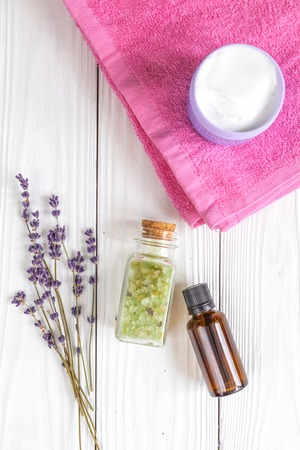 baby accessories with lavander for the bathroom on wooden background top view Stock Photo