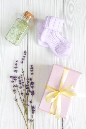 perfumed: baby bath salt with lavender on wooden background top view close up