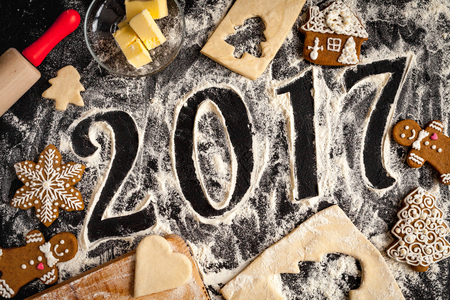 pastry cutters: cooking christmas gingerbread on wooden background top view 2017 new year.