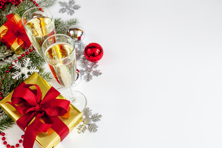 glasses of champagne and christmas ornaments top view on white background stock photo 67321001