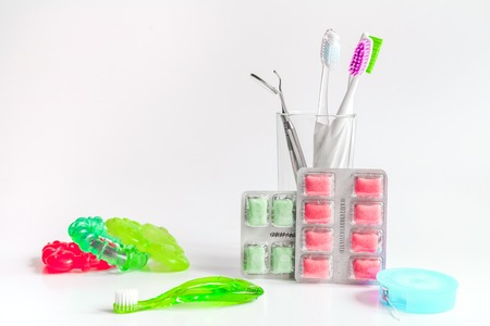 toothbrushes in glass on white background tools for oral care. Stock Photo