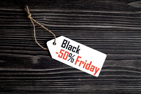 specials: concept black friday on dark wooden background top view. Stock Photo