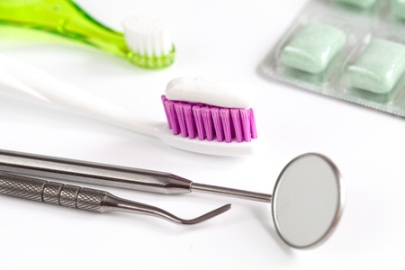 dental care toothbrush with dentist tools on white background close up Stock Photo