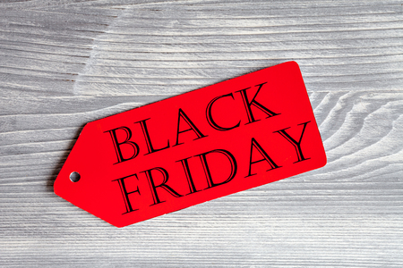 specials: concept black friday on wooden background top view. Stock Photo