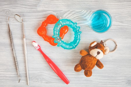 childrens toothbrush oral care on wooden background top view. Stock Photo