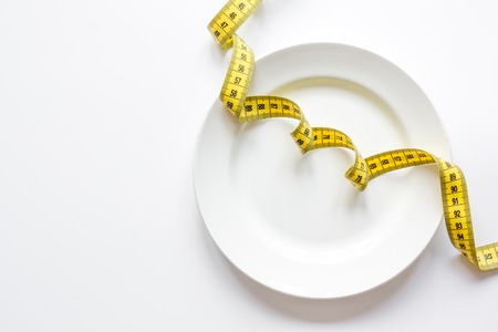 dietetics: concept diet and weight loss on white background top view.