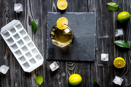 manlike: glass of whiskey on dark wooden background top view. Stock Photo