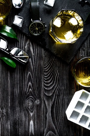 glass of scotch on dark wooden background top view. Stock Photo
