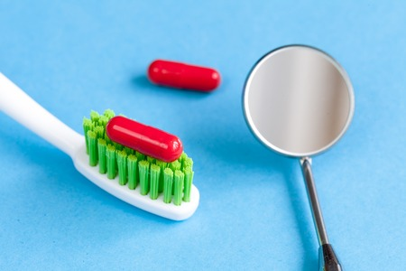 concept tooth pain - dentist tools, tablet at blue background close up