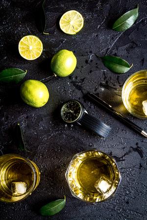 glass of scotch on dark background top view.