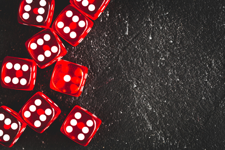 risk concept - playing dice at dark background top view