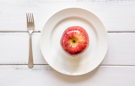 dietetics: concept diet and weight loss on wooden background top view.