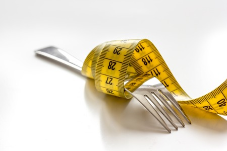 dietetics: concept diet and weight loss on white background close up