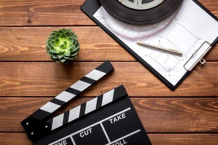 screenwriter: Work screenwriter on wooden background top view.