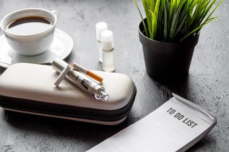 elimination: elimination of tobacco smoking electronic cigarette on dark background close up Stock Photo